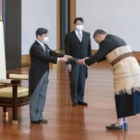 Emperor Naruhito (left) attends a ceremony to mark the arrivals of foreign envoys, including Tonga's new Ambassador Tevita Suka Mangisi (right) Wednesday at the Imperial Palace. | IMPERIAL HOUSEHOLD AGENCY / VIA KYODO
