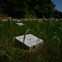 Gravestones at the Military Cemetery for North Korean soldiers in Paju, South Korea. | AFP-JIJI
