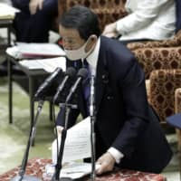 Earlier this month, Finance Minister Taro Aso claimed that Japan's relatively low COVID-19 death rate is due to 'the superiority of its people.' | BLOOMBERG