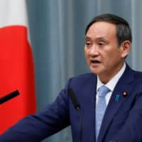 China asks Japan to maintain 'exclusively defense-oriented' policy