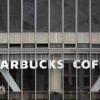 A new Starbucks outlet opening in Japan with sign language ability for hearing impaired customers will be the fifth 'signing store' globally run by the U.S. coffee chain, as it is stepping up efforts to create stores with a focus on diversity and inclusion. | REUTERS