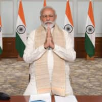 Prime Minister Narendra Modi pays tribute to Indian soldiers killed during a confrontation with Chinese soldiers in the Ladakh region. | INDIA GOVERNMENT PRESS INFORMATION BUREAU / VIA AP