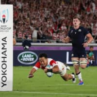Japan's Kenki Fukuoka scores a try against Scotland during the Rugby World Cup on Oct. 13 in Yokohama. | REUTERS