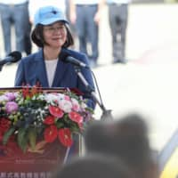 Taiwanese President Tsai Ing-Wen delivers a speech at the first public test flight of the AIDC T-5 Brave Eagle, Taiwan's first locally manufactured advanced jet trainer, in the city of Taichung on Monday.  | REUTERS