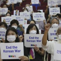 Anti-war activists demand peace on the Korean Peninsula on the eve of the 70th anniversary of the outbreak of the Korean War, in Seoul on Wednesday.  | AP