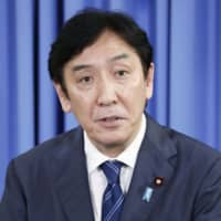 Ex-minister Isshu Sugawara escapes indictment over money scandal