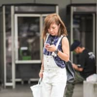Yamato on Thursday became the first municipality in Japan to attempt to stop people using their smartphones while walking outside in public places. | GETTY IMAGES / VIA KYODO