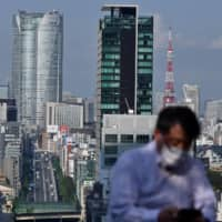 Most Japanese companies still embrace the traditional ways of working, but the COVID-19 pandemic may spur change. | AFP-JIJI
