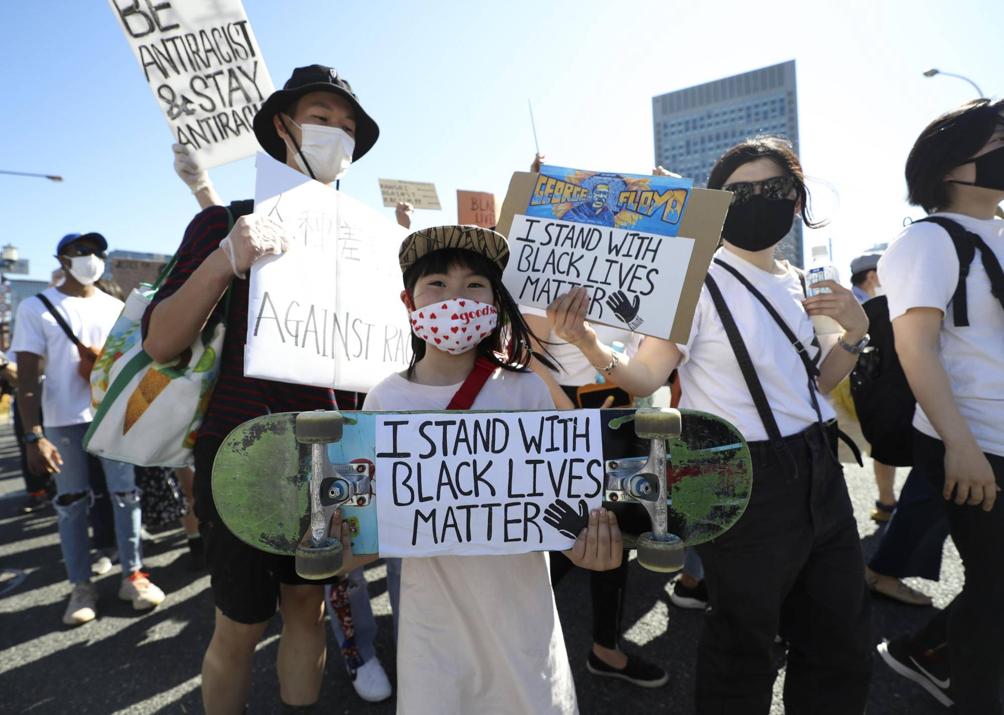 United front: People march in Osaka in solidarity with Black Lives Matter protests overseas. | KYODO