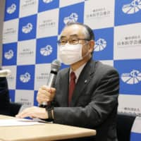 Morito Monden (right), chairman of the Japanese Medical Science Federation, speaks at a news conference in Tokyo Thursday after receiving a panel report on forced sterilization. | KYODO