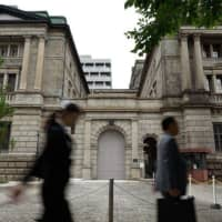 The Bank of Japan may lower its economic projections again next month.  | BLOOMBERG
