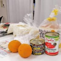 Every bit helps: Food donations at the Japan Association for Refugees. | KYODO