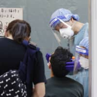Japan's testing operations for the novel coronavirus are focused on potential and identified clusters as opposed to mass testing.   KYODO