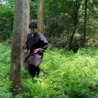 Genichi Mitsuhashi hones his ninja skills in Iga, Mie Prefecture, on June 21. Mitsuhashi has become the first student ever to graduate from a Japanese university with a master's degree in ninja studies.