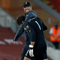 Liverpool manager Jurgen Klopp hugs keeper Alisson after a match against Crystal Palace Wednesday in Liverpool, England. | AFP-JIJI