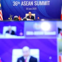 Vietnamese Prime Minister Nguyen Xuan Phuc addresses an Association of Southeast Asian Nations (ASEAN) summit video conference in Hanoi on Friday. | POOL / VIA REUTERS