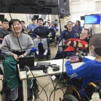 Patients at Yakumo National Hospital in Yakumo, Hokkaido, participate in a para esports tournament. | COURTESY OF YAKUMO NATIONAL HOSPITAL / VIA KYODO