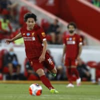 Liverpool's Takumi Minamino controls the ball during a match against Crystal Palace on Wednesday in Liverpool, England. | AP