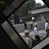 Tokyo City Hall reported 57 coronavirus infections on Saturday, the highest number since the national state of emergency was completely lifted on May 25. | AP