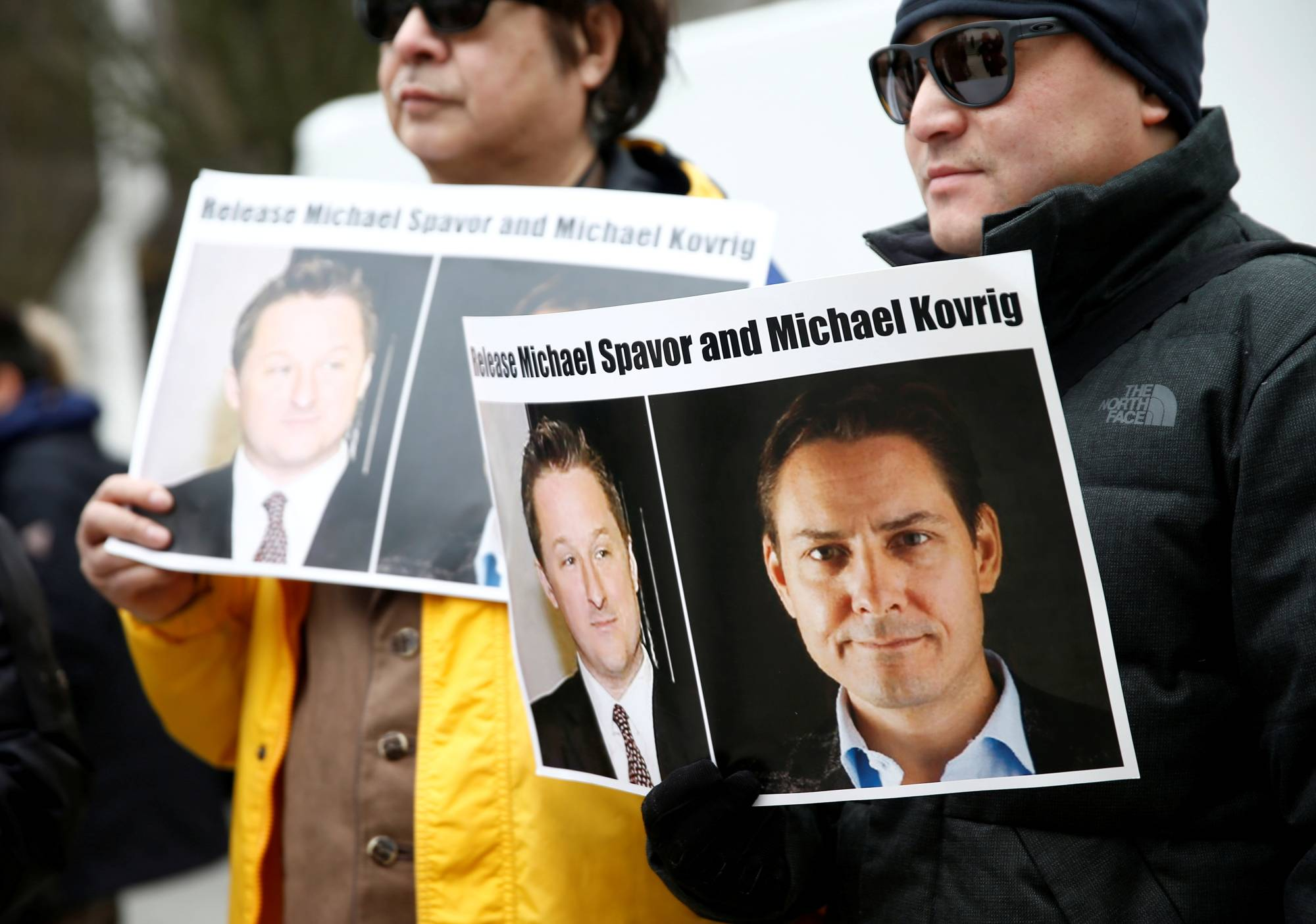 People hold signs calling for China to release Canadian detainees Michael Spavor and Michael Kovrig during an extradition hearing for Huawei Technologies Chief Financial Officer Meng Wanzhou at the British Columbia Supreme Court in Vancouver, Canada, in March last year.   REUTERS