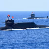A Chinese Navy nuclear-powered Type 094A Jin-class ballistic missile submarine is seen during a military parade in the South China Sea in April 2018.  | REUTERS