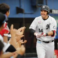 Lotte's Brandon Laird returns to the bench after hitting a go-ahead home run in the eighth inning on Sunday in Chiba. | KYODO