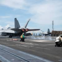 A U.S. F/A-18F Super Hornet takes off from the flight deck of the Navy's only forward-deployed aircraft carrier, the Yokosuka, Kanagawa-based USS Ronald Reagan, in the Philippine Sea on June 16. | U.S. NAVY