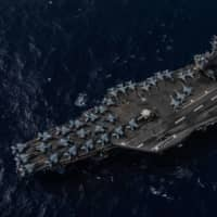 U.S. aircraft carriers hold joint drills after ASEAN lambastes Beijing over South China Sea