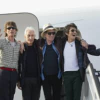 Members of The Rolling Stones pose for photos in Havana, Cuba in March 2016. The group is threatening U.S. President Donald Trump with legal action for using their songs at his reelection campaign rallies despite cease-and-desist directives. | AP