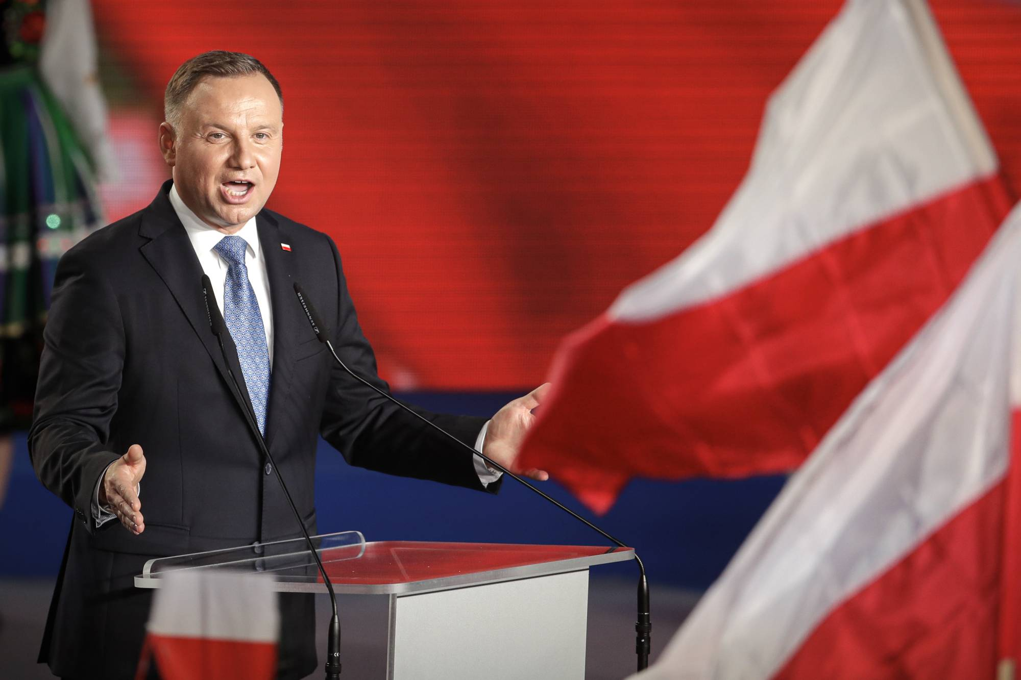 President Andrzej Duda addressees supporters after voting ended in the presidential election in Lowicz, Poland, on Sunday. | AP
