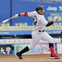 Brandon Laird homers against the Buffaloes in the eighth inning on Sunday at Zozo Marine Stadium. | KYODO