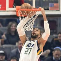 Jazz center Rudy Gobert dunks during a game against the Cavaliers on March 2 in Cleveland.  | USA TODAY / VIA REUTERS