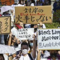 Spreading awareness: People march in support of Black Lives Matter in Osaka on June 7.  | KYODO