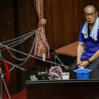 A lawmaker, part of a group consisting of more than 20 from Taiwan's main opposition party the Kuomintang, looks on while occupying the Legislative Yuan in Taipei on Monday. |  REUTERS