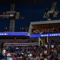 The upper section of the BOK Center is seen partially empty as U.S. President Donald Trump speaks during a campaign rally in Tulsa, Oklahoma, on June 20.   | AFP-JIJI