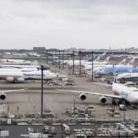 Airplanes sit idle at Narita International Airport near Tokyo on May 21 due to flight suspensions over the coronavirus pandemic. | KYODO