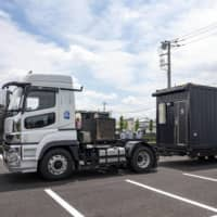 A mobile container hotel is shipped to the city of Mitaka in Tokyo. | DEVELOP CO. / VIA KYODO