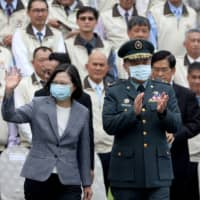 Taiwan President Tsai Ing-Wen greets members of the Armed Forces Reserve Command in Taipei on Monday.  | REUTERS