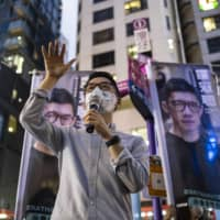 Nathan Law speaks during a news conference to announce his bid to enter into the unofficial pro-democratic camp primary election for the Legislative Council in Hong Kong on June 19.  | BLOOMBERG
