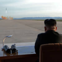 North Korean leader Kim Jong Un watches the launch of a Hwasong-12 intermediate-range ballistic missile in this photo released in September 2017. Nuclear-armed Pyongyang could be weighing a summit — or provocation — ahead of November's U.S. presidential election, experts say. | KCNA / VIA REUTERS