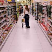 Supermarket operator Aeon Co. has seen a rise in shoppers turning to the internet for supplies as a result of the pandemic. | REUTERS