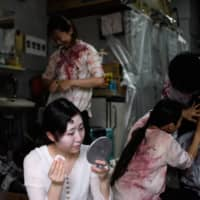 Actors and actresses are required to wear copious amounts of make-up to help create the full zombie effect. | AFP-JIJI
