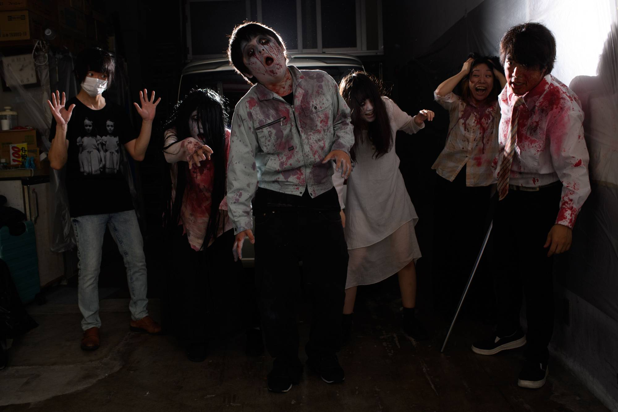 The horror of the haunted house stays firmly out of reach, with guests being safely enclosed in their cars. | AFP-JIJI