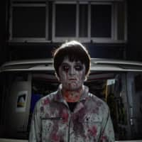 Producer Kenta Iwana leads the squad of actors who usually create haunted houses at amusement parks and similar venues. | AFP-JIJI