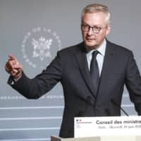French Finance Minister Bruno Le Maire has called the withdrawal of the Trump administration from negotiations on a major digital services tax a 'provocation' and warned that a tax will be applied 'on digital giants in 2020.' | AP
