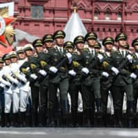 Soldiers of the China's People's Liberation Army march during the Victory Day Parade in Moscow on June 24. | POOL / VIA REUTERS