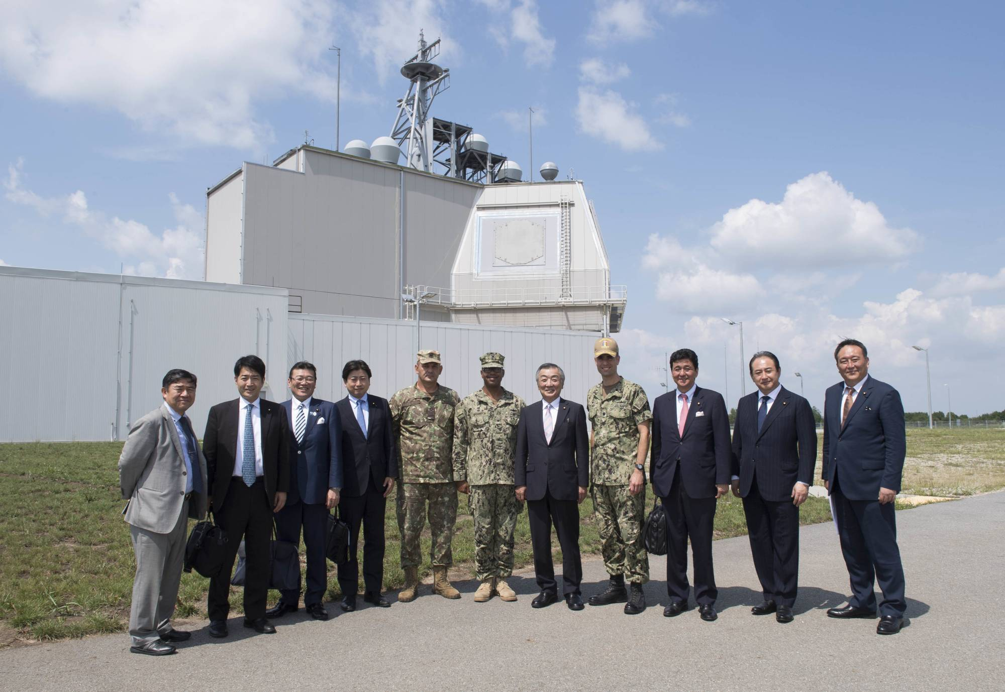 Diet members visit a U.S. Aegis Ashore installation in Romania on July 31, 2018. The National Security Council has endorsed plans to cancel the deployment of the costly missile defense system aimed at bolstering Japan's capability against threats from North Korea. | U.S. NAVY