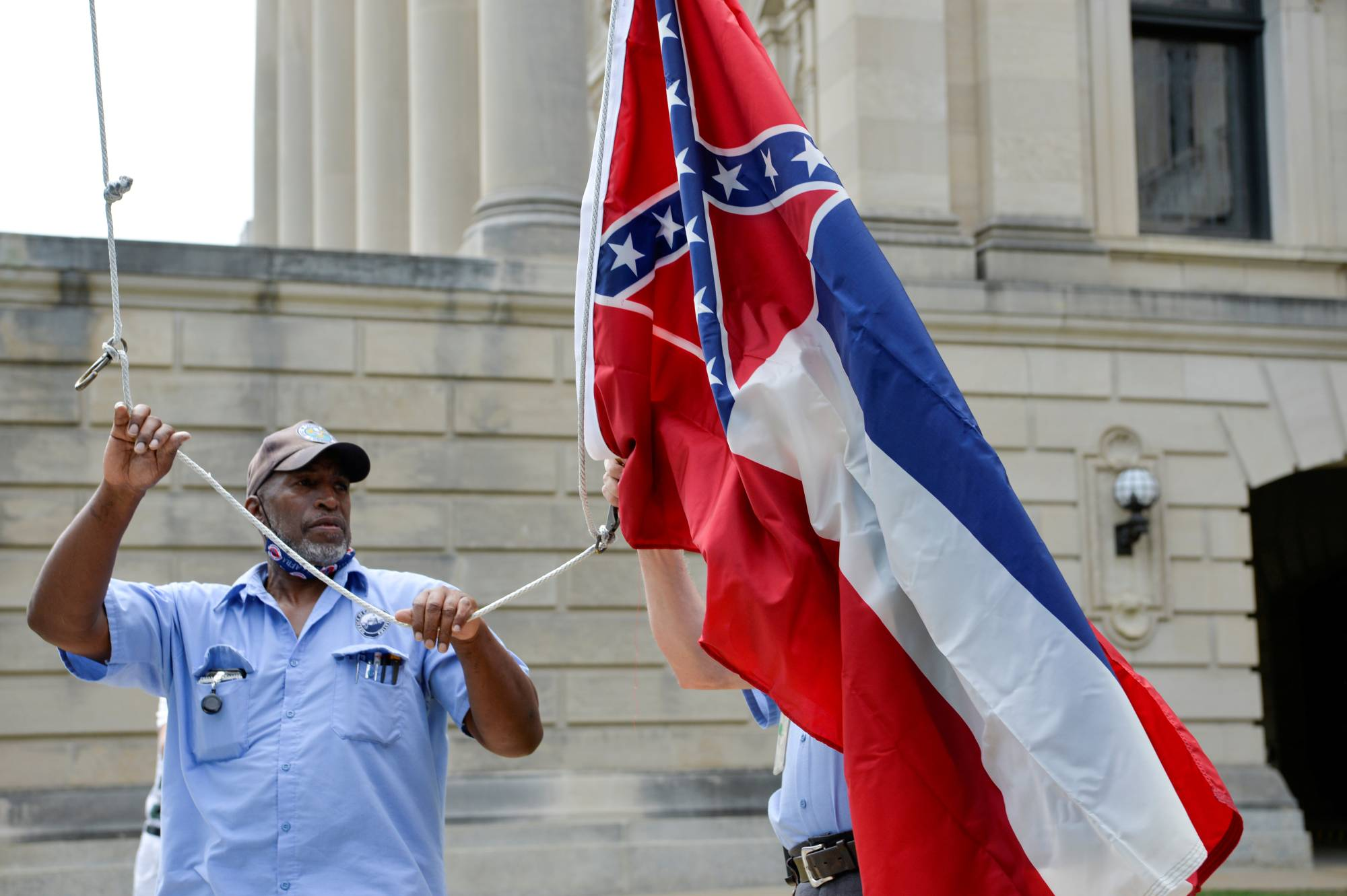 The Mississippi state flag, which prominently features the so-called Confederate battle flag, had flown above the state Capitol building in Jackson for 126 years. It was taken down this weekend after lawmakers approved a bill to replace it with a new flag.  | REUTERS