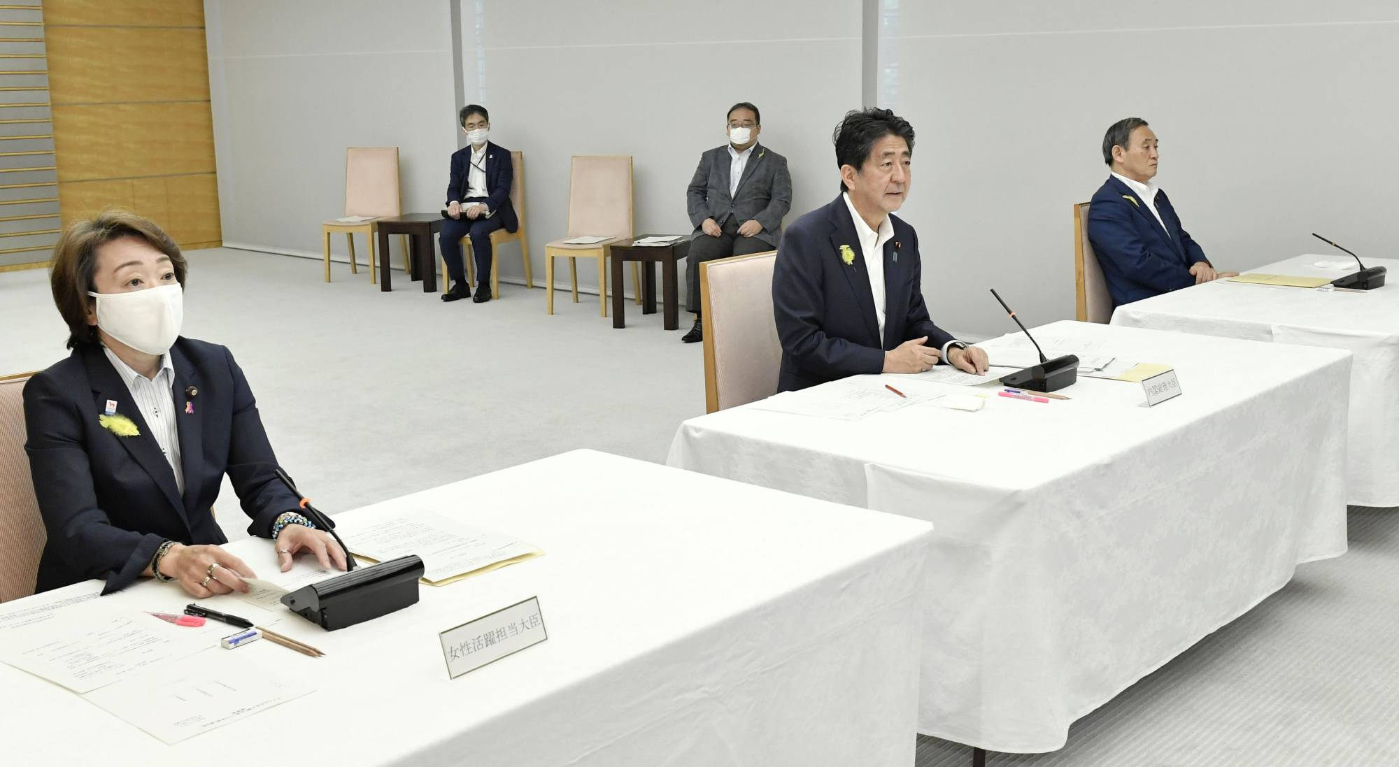 Prime Minister Shinzo Abe (center) addresses a meeting on female empowerment held at the Prime Minister's Office on Wednesday. | KYODO