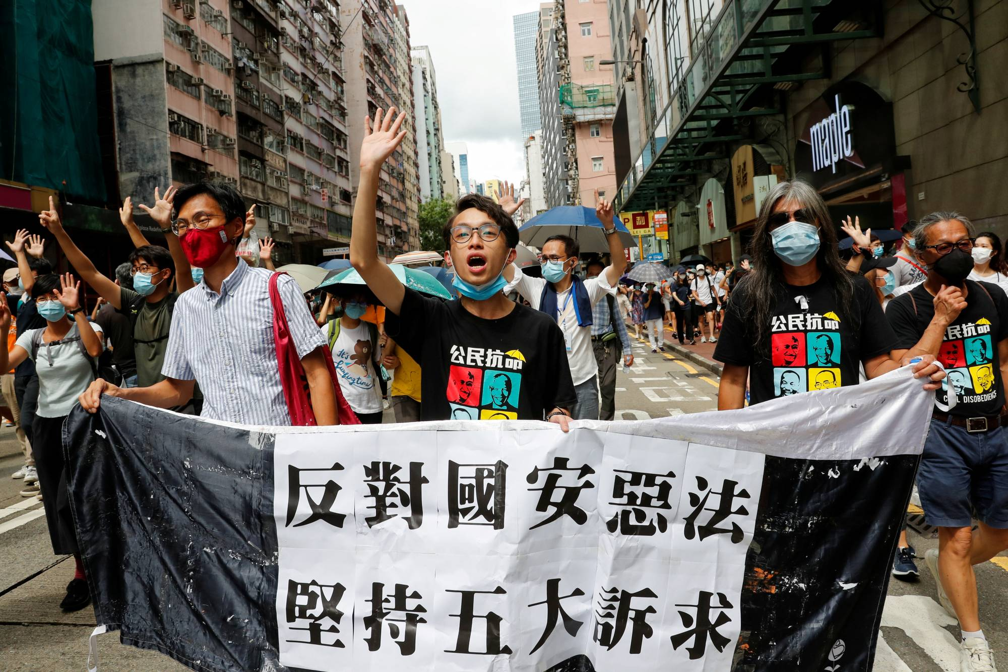 Activists march at the anniversary of Hong Kong's handover to China from Britain in the financial hub on Wednesday.  | REUTERS